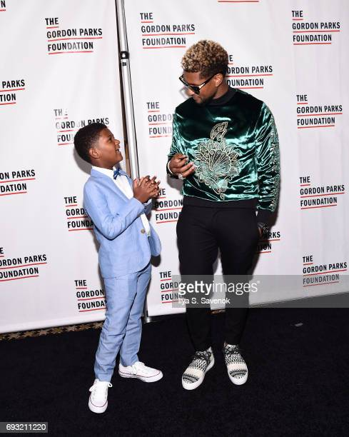 Singersongwriter Usher Raymond IV and his son Naviyd Ely Raymond attend the 2017 Gordon Parks Foundation Awards Gala at Cipriani 42nd Street on June...