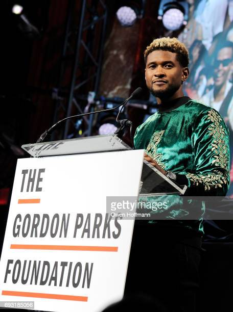 Singersongwriter Usher speaks onstage during the Gordon Parks Foundation Awards Dinner Auction at Cipriani 42nd Street on June 6 2017 in New York City