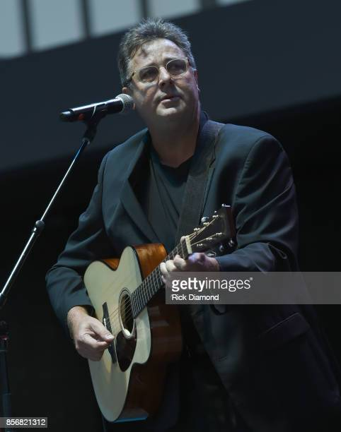 Singer/Songwriter Vince Gill performs 'Go Rest High on the Mountain' during Nashville Candelight Vigil For Las Vegas at Ascend Amphitheater on...