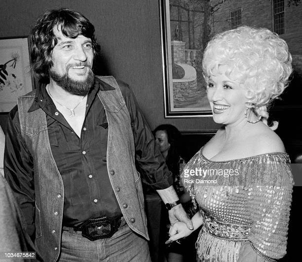 Singer/Songwriter Waylon Jennings and Singer/Songwriter/Actor Dolly Parton attend The Best Little Whorehouse In Texas premiere at Opryland on July 21...