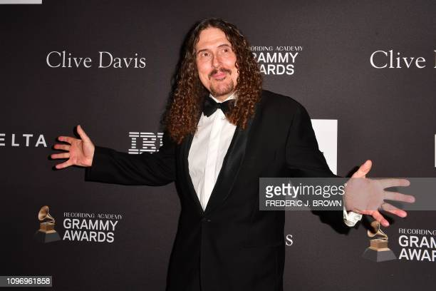 US singersongwriter 'Weird Al' Yankovic arrives for the traditional Clive Davis party on the eve of the 61th Annual Grammy Awards at the Beverly...