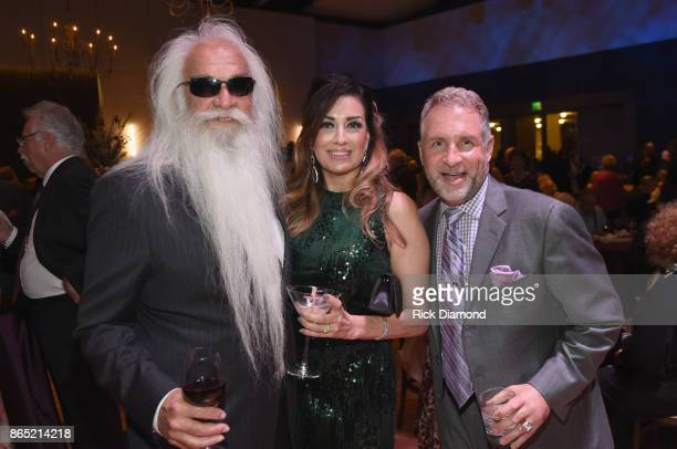 Singersongwriter William Lee Golden of The Oak Ridge Boys Simone De Staley and Darrick Kinslow take photos at the Medallion Ceremony to celebrate...