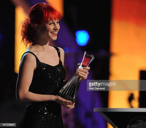 Singer/Songwriter with the Rock Group Paramore, Hayley Nichole Williams presents to Taylor Swift at the CMT Artists of the Year at The Factory on...
