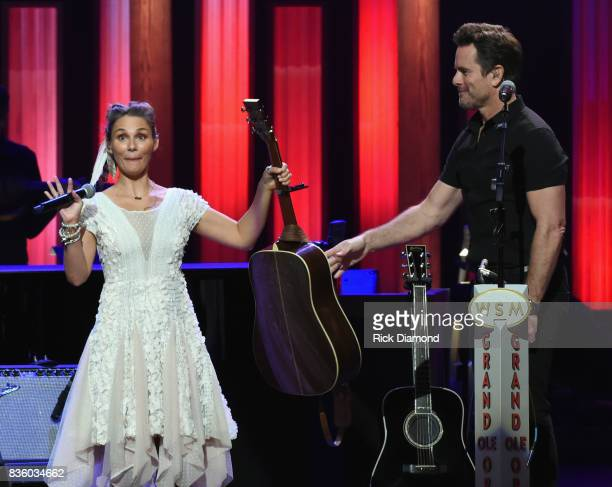 Singer/Songwriter/Actor Clare Bowen joins Singer/Songwriter/Actor Charles Esten on stage during Grand Ole Opry Total Eclipse 2017 Special Sunday...