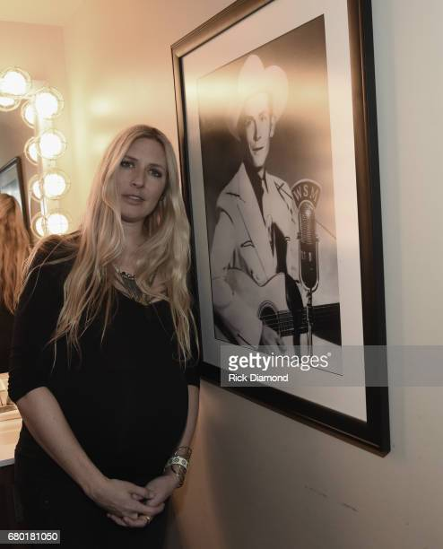 Singer/Songwriter/GrandDaughter of Hank Williams Sr Holly Williams pose by Hank Sr photograph in the Hank Williams room backstage at The Ryman during...