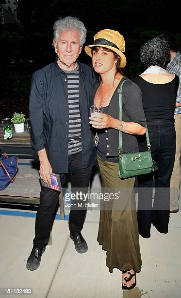 Singersongwriter/photographer Graham Nash OBE and model Uschi Obermaier attend the showcase of his latest work at Frank Langen Gallery on September 1...