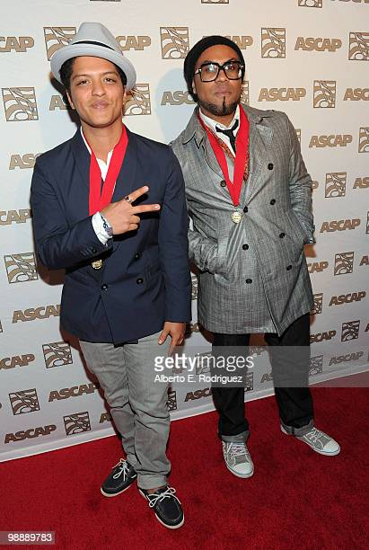 Singer/songwriter/producer Bruno Mars and singer/songwriter/producer Phillip Lawrence arrive at the 27th Annual ASCAP Pop Music Awards held at the...