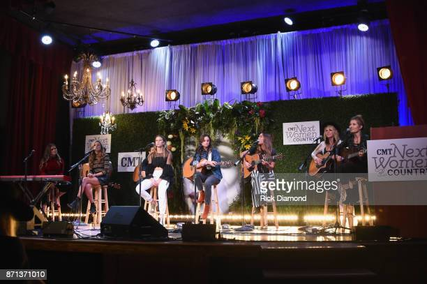 Singersongwriters Abby Anderson Carly Pearce Kassi Ashton Bailey Bryan Naomi Cook Hannah Mulholland and Jennifer Wayne of musical trio Runaway June...