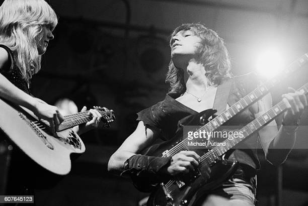 Singersongwriters and guitarists Nancy Wilson and her sister Ann Wilson performing with American hard rock band Heart at Portland Memorial Coliseum...