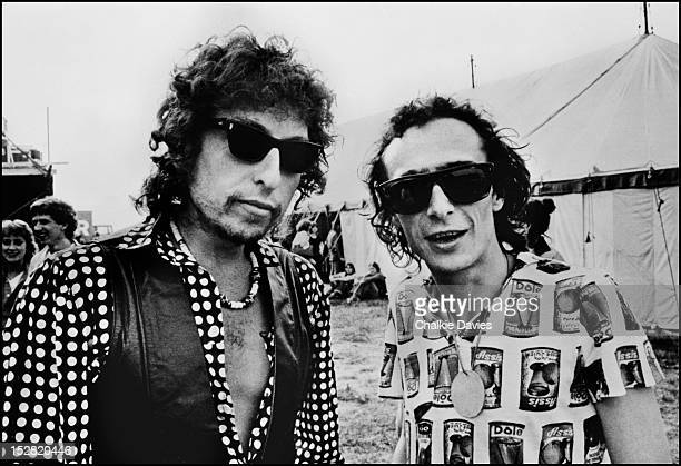 Singersongwriters Bob Dylan and Graham Parker backstage at The Picnic at Blackbushe Aerodrome Hampshire 15th July 1978