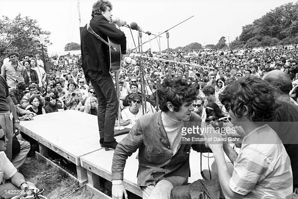 Singer/songwriters Bob Dylan performing and Donovan making his US debut at the Newport Folk Festival in July 1965 in Newport Rhode Island