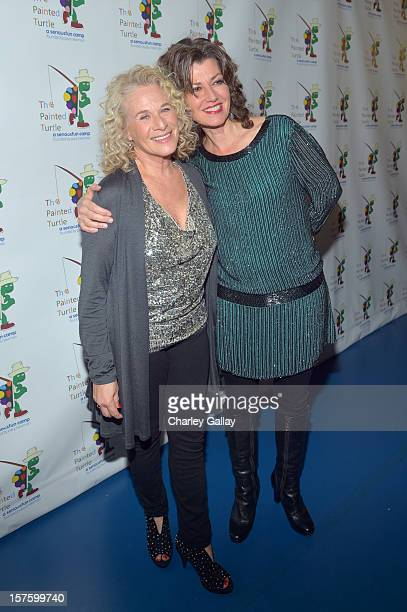 Singer/songwriters Carole King and and Amy Grant arrive at a celebration of Carole King and her music to benefit Paul Newman's The Painted Turtle...