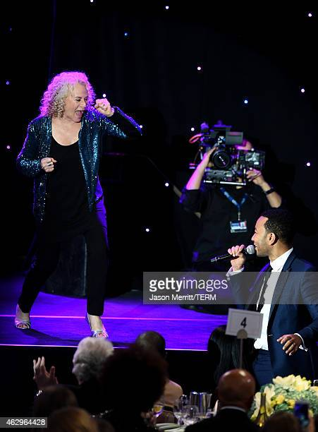 Singersongwriters Carole King and John Legend perform onstage at the PreGRAMMY Gala and Salute To Industry Icons honoring Martin Bandier at The...