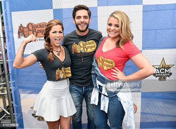 Singersongwriters Cassadee Pope and Thomas Rhett and singer Lauren Alaina attend the Cracker Barrel Old Country Store Country Checkers Challenge at...