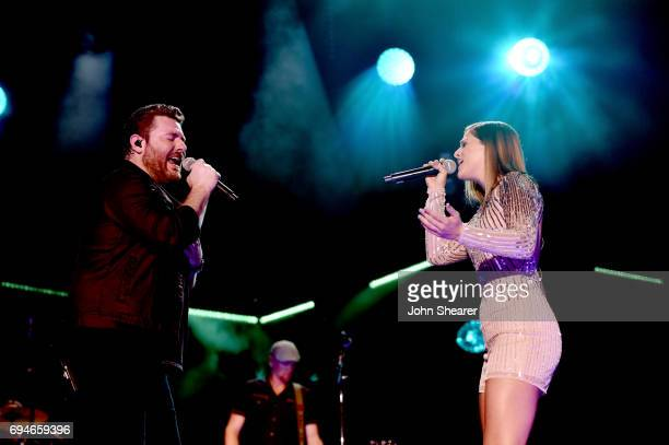 Singer-songwriters Chris Young and Cassadee Pope perform onstage of day 3 at the 2017 CMA Music Festival on June 10, 2017 in Nashville, Tennessee.