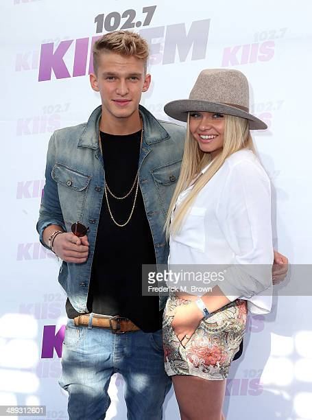 Singer/songwriters Cody Simpson and Alli Simpson attend 1027 KIIS FM's 2014 Wango Tango at StubHub Center on May 10 2014 in Los Angeles California