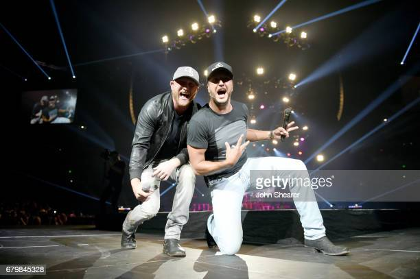 Singersongwriters Cole Swindell and Luke Bryan perform on stage and Kicks off the Huntin' Fishin' And Lovin' Every Day Tour at Bridgestone Arena on...