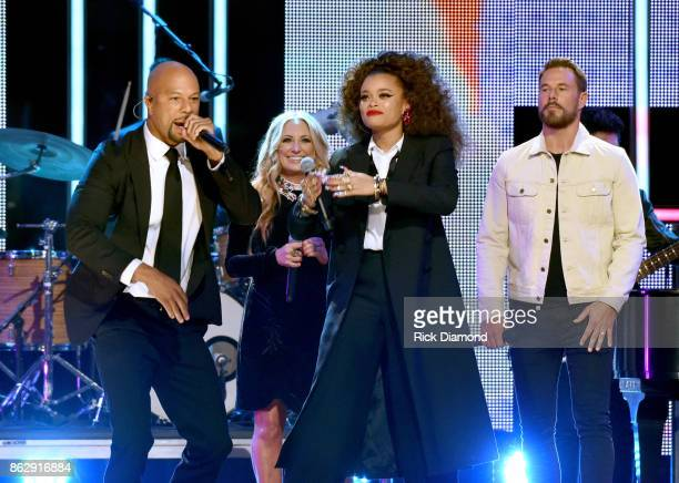 Singersongwriters Common Lee Ann Womack Andra Day and Jimi Westbrook of Little Big Town perform onstage at the 2017 CMT Artists Of The Year on...