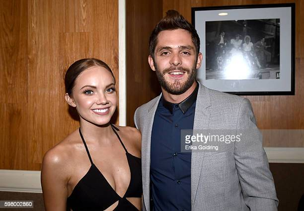 Singersongwriters Danielle Bradbery and Thomas Rhett pose backstage during 10th Annual ACM Honors at the Ryman Auditorium on August 30 2016 in...