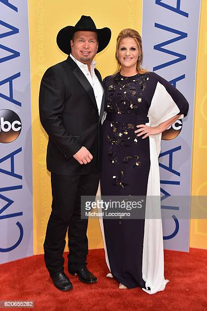 Singersongwriters Garth Brooks and Trisha Yearwood attend the 50th annual CMA Awards at the Bridgestone Arena on November 2 2016 in Nashville...