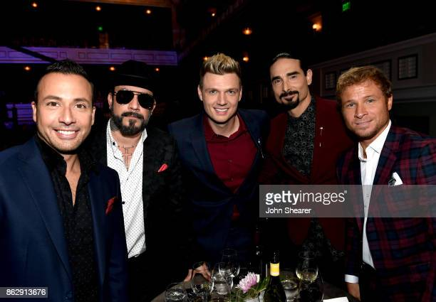 Singersongwriters Howie Dorough AJ McLean Nick Carter Kevin Richardson and Brian Littrell of Backstreet Boys take photos during the 2017 CMT Artists...