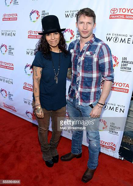 Singersongwriters James Blunt and Linda Perry attend An Evening with Women benefiting the Los Angeles LGBT Center at the Hollywood Palladium on May...