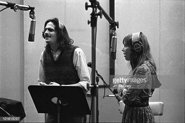Singersongwriters James Taylor and Joni Mitchell provide backing vocals during the recording of Carole King's album 'Tapestry' at AM Records...