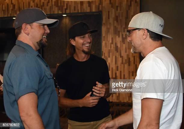 Singer/Songwriters Jason Aldean Brad Warren and Brett Warren backstage during Jason Aldean's Triple Party at Wildhorse Saloon on August 2 2017 in...