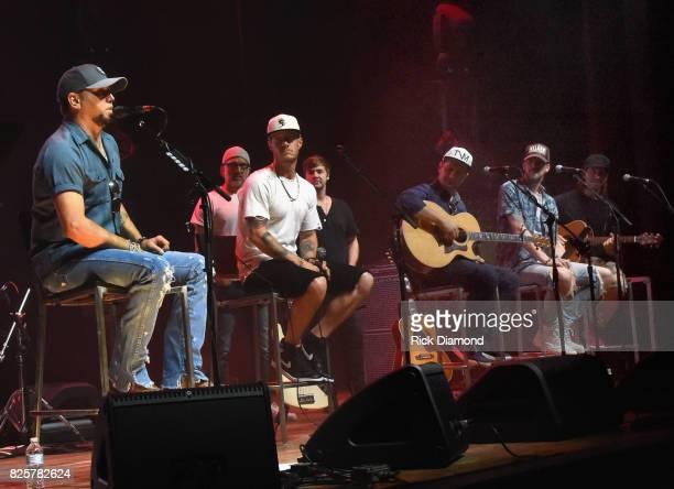 Singer/Songwriters Jason Aldean Brett Warren Tyler Hubbard Jimmy Robbins Deric Ruttan Brian Kelley and Brad Warren performs during Jason Aldean's...