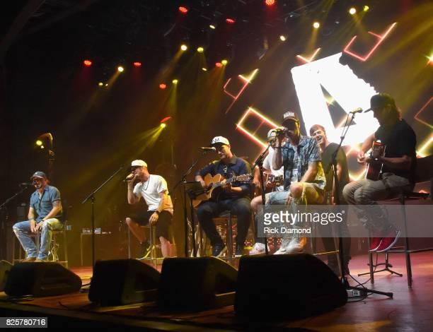 Singer/Songwriters Jason Aldean Tyler Hubbard Deric Ruttan Brett Warren Brian Kelley Jimmy Robbins and Brad Warren performs during Jason Aldean's...