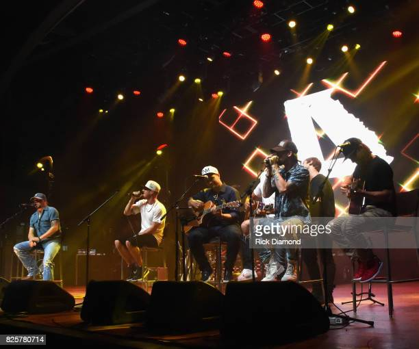 Singer/Songwriters Jason Aldean Tyler Hubbard Deric Ruttan Brian Kelley Jimmy Robbins and Brad Warren performs during Jason Aldean's Triple Party at...