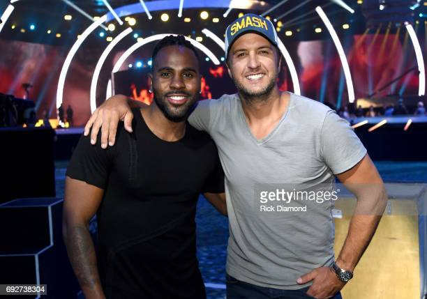 Singersongwriters Jason Derulo and Luke Bryan pose for a photo during the 2017 CMT Music Awards Rehearsals at Music City Convention Center on June 5...