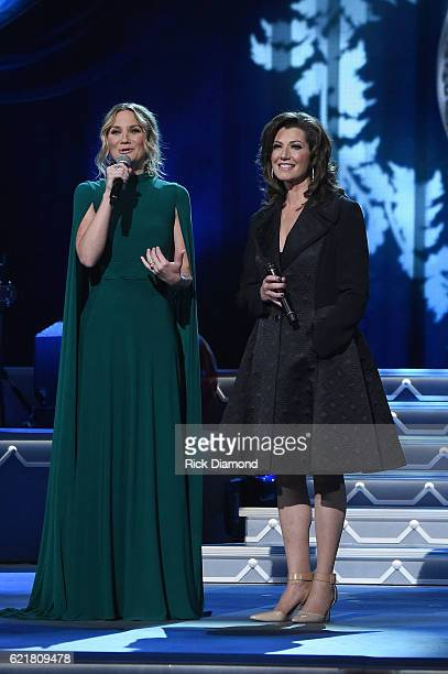 Singersongwriters Jennifer Nettles and Amy Grant perform on stage during the CMA 2016 Country Christmas on November 8 2016 in Nashville Tennessee