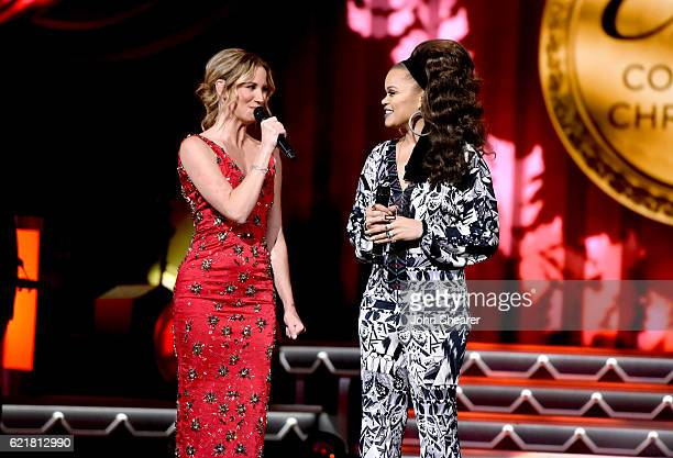 Singer-songwriters Jennifer Nettles and Andra Day perform on stage during the CMA 2016 Country Christmas on November 8, 2016 in Nashville, Tennessee.