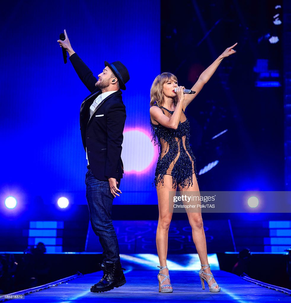 Singer-songwriters Justin Timberlake (L) and Taylor Swift perform onstage during Taylor Swift The 1989 World Tour Live In Los Angeles at Staples Center on August 26, 2015 in Los Angeles, California.