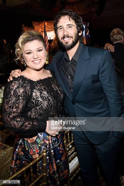 Singer/songwriters Kelly Clarkson and Josh Groban attend Muhammad Ali's Celebrity Fight Night XXI at the JW Marriott Phoenix Desert Ridge Resort Spa...
