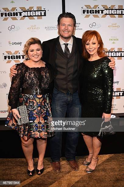Singer/songwriters Kelly Clarkson Blake Shelton and Reba McEntire attend Muhammad Ali's Celebrity Fight Night XXI at the JW Marriott Phoenix Desert...