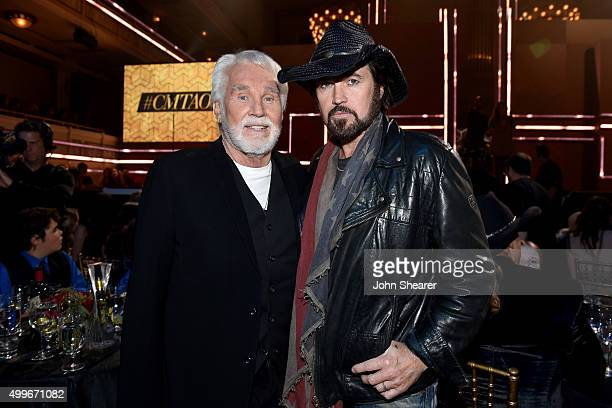 Singersongwriters Kenny Rogers and Billy Ray Cyrus attend the 2015 CMT Artists of the Year at Schermerhorn Symphony Center on December 2 2015 in...