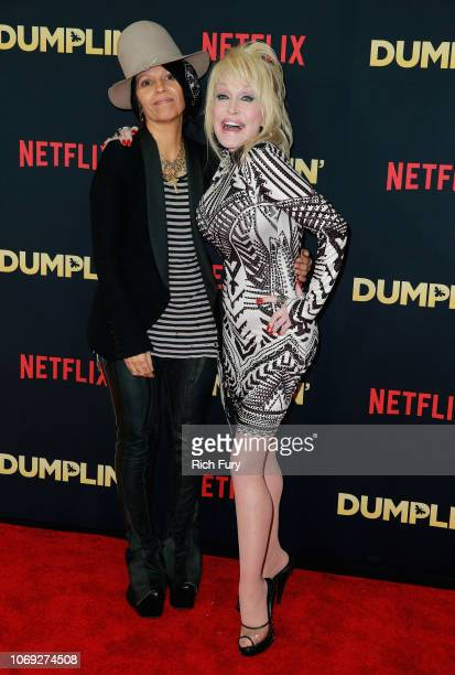 Singersongwriters Linda Perry and Dolly Parton attend the premiere of Netflix's Dumplin' at TCL Chinese 6 Theatres on December 6 2018 in Hollywood...