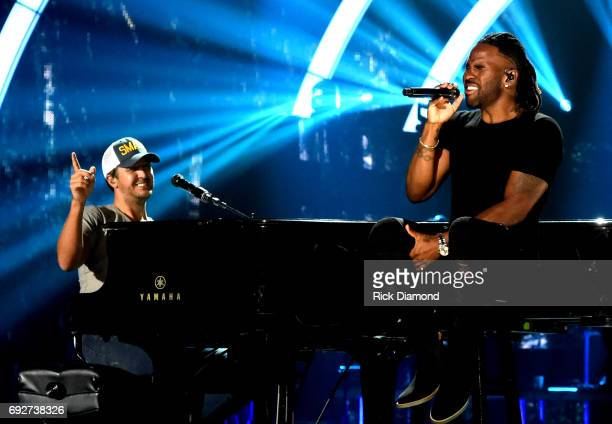 Singersongwriters Luke Bryan and Jason Derulo perform onstage during the 2017 CMT Music Awards Rehearsals at Music City Convention Center on June 5...