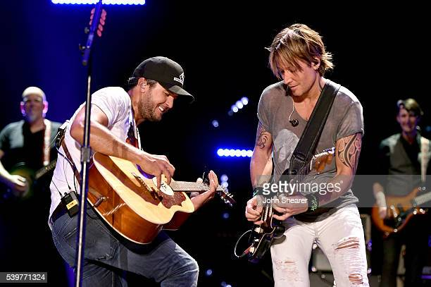 Singersongwriters Luke Bryan and Keith Urban perform onstage during 2016 CMA Festival Day 4 at Nissan Stadium on June 12 2016 in Nashville Tennessee