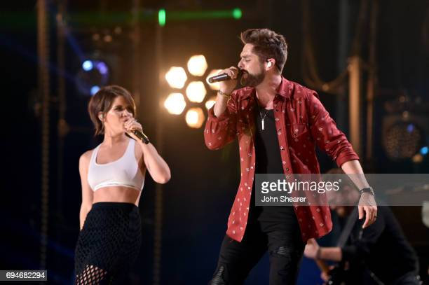 Singer-songwriters Maren Morris and Thomas Rhett perform onstage of day 3 at the 2017 CMA Music Festival on June 10, 2017 in Nashville, Tennessee.