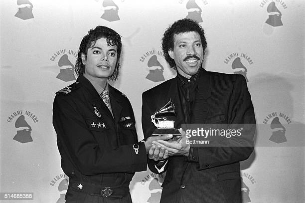 Singersongwriters Michael Jackson and Lionel Ritchie hold their Grammy Award for 'We Are the World'