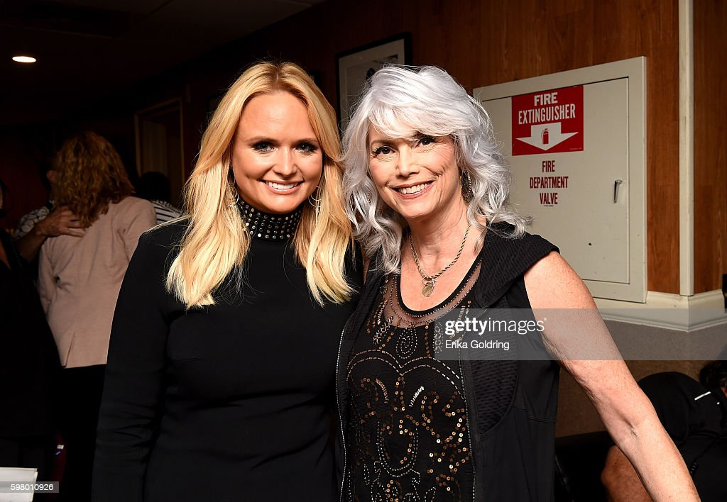 Singer-songwriters Miranda Lambert and Emmylou Harris backstage during the 10th Annual ACM Honors at the Ryman Auditorium on August 30, 2016 in Nashville, Tennessee.