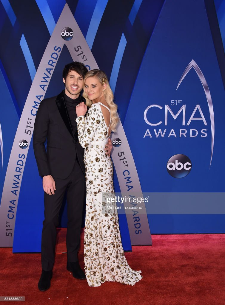 Singer-songwriters Morgan Evans (L) and Kelsea Ballerini attend the 51st annual CMA Awards at the Bridgestone Arena on November 8, 2017 in Nashville, Tennessee.