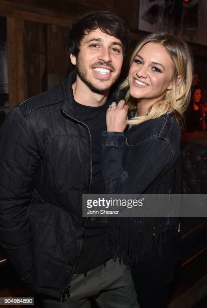 Singersongwriters Morgan Evans and Kelsea Ballerini attend the Nashville Opening of Dierks Bentley's Whiskey Row on January 14 2018 in Nashville...