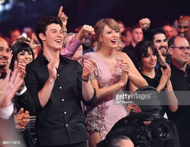Singersongwriters Shawn Mendes and Taylor Swift during the 2018 Billboard Music Awards at MGM Grand Garden Arena on May 20 2018 in Las Vegas Nevada