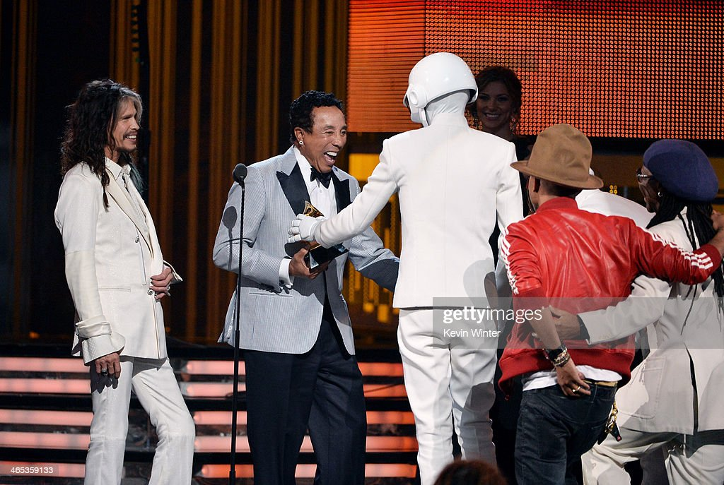 Singer/songwriters Steven Tyler and Smokey Robinson present award for Record of the Year to musicians Daft Punk, accompanied by singer/songwriter Pharrell Williams and producer Nile Rodgers onstage during the 56th GRAMMY Awards at Staples Center on January 26, 2014 in Los Angeles, California.