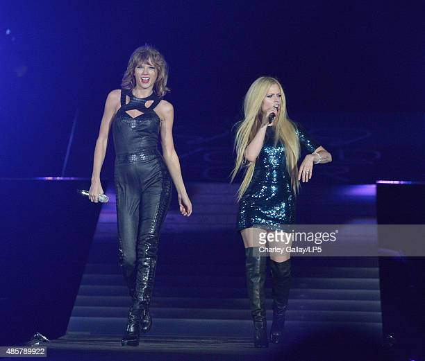 Singer-songwriters Taylor Swift and Avril Lavigne performs onstage during Taylor Swift The 1989 World Tour Live In San Diego at PETCO Park on August...