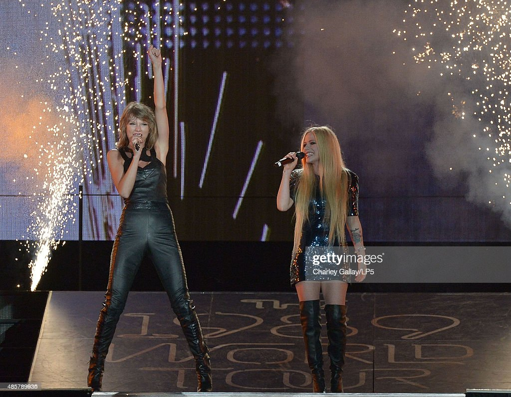 Singer-songwriters Taylor Swift (L) and Avril Lavigne performs onstage during Taylor Swift The 1989 World Tour Live In San Diego at PETCO Park on August 29, 2015 in San Diego, California.